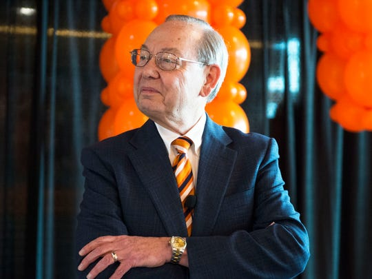 University of Tennessee Chancellor Jimmy Cheek listens as the media asks him a question at a party celebrating his return to teaching after eight years in the chancellor position in Neyland Stadium Wednesday, Feb. 8, 2017.
