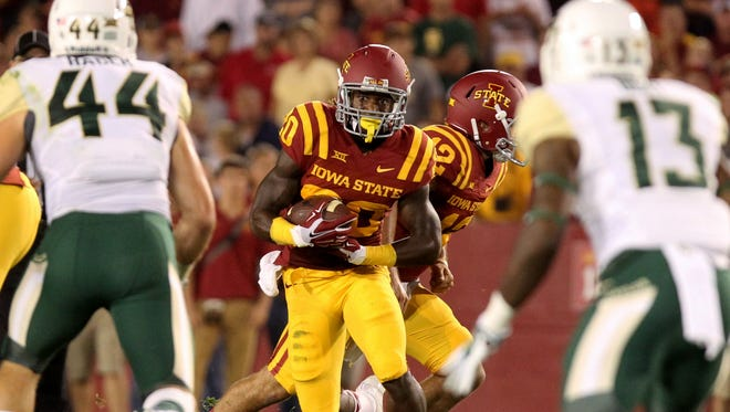 Iowa State Cyclones running back DeVondrick Nealy (20) looks for running room against the Baylor Bears defense at Jack Trice Stadium.