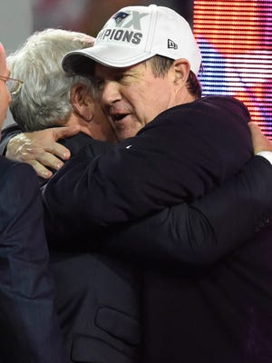 New England Patriots head coach Bill Belichick and owner Robert Kraft embrace after the victory over the Seattle Seahawks 28-24 in Super Bowl XLIX at University of Phoenix Stadium.