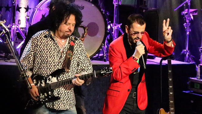 Ringo Starr, right, performs with guitarist Steve Lukather of the band Toto Monday night in the Abraham Chavez Theatre.