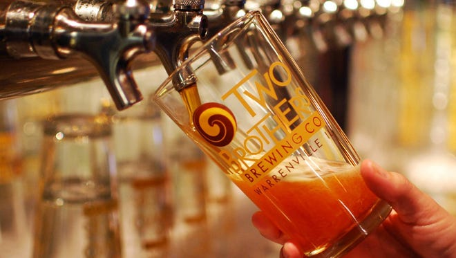 Jim and Jason Ebel, founders of Illinois-based Two Brothers Brewing Company, will open Two Brothers Taphouse and Brewery in Old Town Scottsdale on Thursday, Jan. 22.