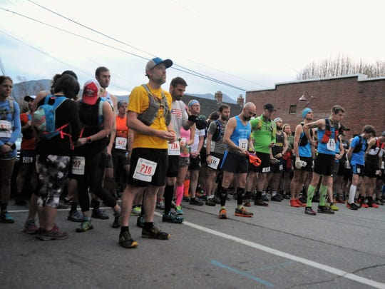 Runners in the 2018 Mount Mitchell Challenge and Black Mountain Marathon take a moment of silence before the race in remembrance of the Rev. Billy Graham, whose funeral procession passed through Black Mountain later that day.