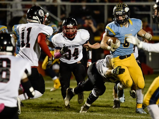 River Valley's Tyler Spears tries to break a tackle
