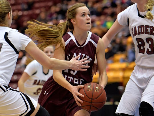 Sauk Centre junior Jill Klaphake (13) drives the ball