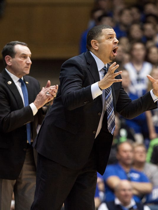 FILE - In this Jan. 27, 2018, file photo, Duke associate head coach Jeff Capel, right, and Duke head coach Mike Krzyzewski gesture during the second half of an NCAA college basketball game against Virginia, in Durham, N.C. Pittsburgh is turning to Jeff Capel to turn around its struggling basketball program. A person with direct knowledge of the agreement tells The Associated Press that Capel will take over Kevin Stallings, who was fired earlier this month. The person spoke on the condition of anonymity because the deal was not formally announced. (AP Photo/Ben McKeown, File)