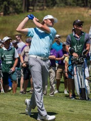 Mardy Fish hits a tee shot during the American Century