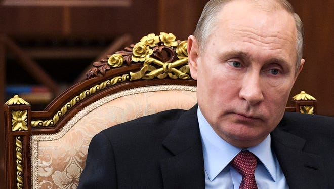 Russian President Vladimir Putin attends a meeting in the Kremlin in Moscow on Jan. 12.