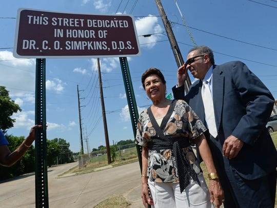 Dr. C.O. Simpkins and his wife Elaine pose next to a sign dedicating a section of Allen Avenue in his honor. Simpkins was honored for his civil rights activities as well as his political and social involvement in Shreveport over the years.