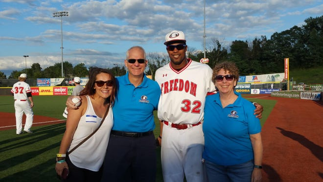 "Paul and Barb Trickel have been a Florence Freedom host family for the past five years. The most recent player they've welcomed into their home is Andrew Godbold, who they consider their ""son."" From left is Paul and Barb's daughter Kelsea, Paul Trickel, Godbold, and Barb Trickel."