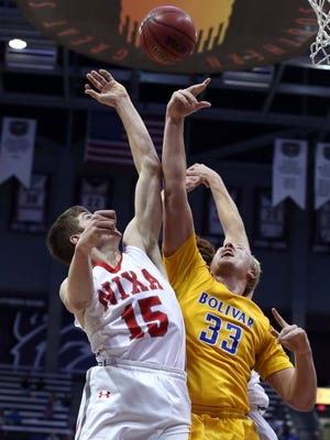 From left, Nixa's Preston Flood (15) battles with Bolivar's Brandon Emmert for a rebound in the 70th Greenwood Blue and Gold Tournament. Nixa and Bolivar are both top 10 teams in their respective classes in the Missouri Basketball Coaches Association rankings for Jan. 13, 2016.