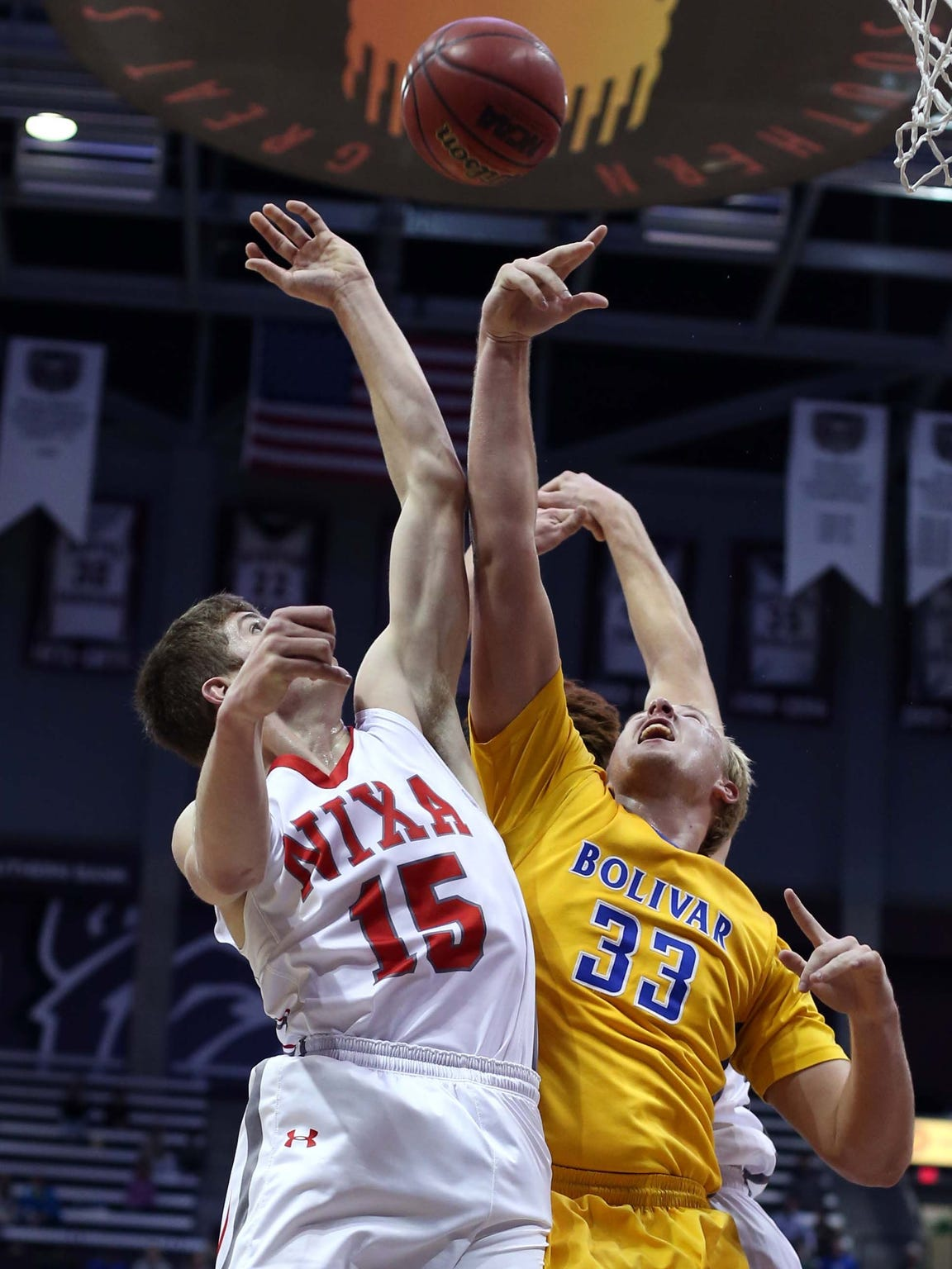 Bolivar's Brandon Emmert (right) battles for a rebound