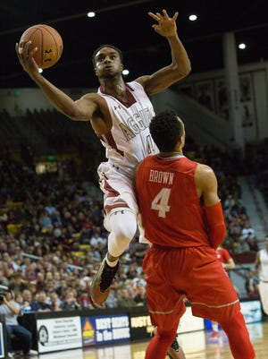 New Mexico State's Ian Baker, left, was named Western Athletic Conference Player of the Year on Tuesday.