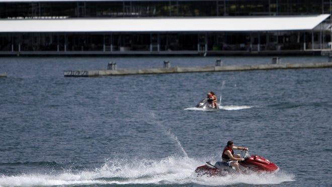 A man rides a jet ski near State Park Marina on Table Rock Lake Wednesday, July 2, 2014.