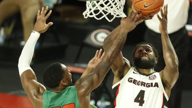 Georgia's Andrew Garcia (4) gets the rebound during an NCAA basketball game between Georgia and Florida A&M. The Bulldogs won 85-75.