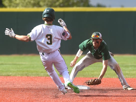 Bishop Manogue's Paul Vossen (3) gets tagged out at