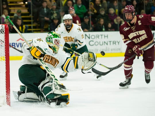 Vermont goalie Stefanos Lekkas (40) makes a glove save during the men's hockey game between the Boston College Eagles and the Vermont Catamounts at Gutterson Field House on Friday night November 10, 2017 in Burlington.