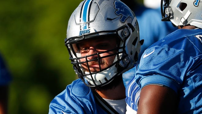 Lions offensive tackle Taylor Decker blocks Corey Robinson (70) during NFL football practice in Allen Park on Monday.