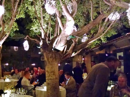 TDS-NBR-1202-WV-Food-Le-VAllauris---elegant-patio-with-uplit-fichus-trees-tables-glowing-with-candles.jpg