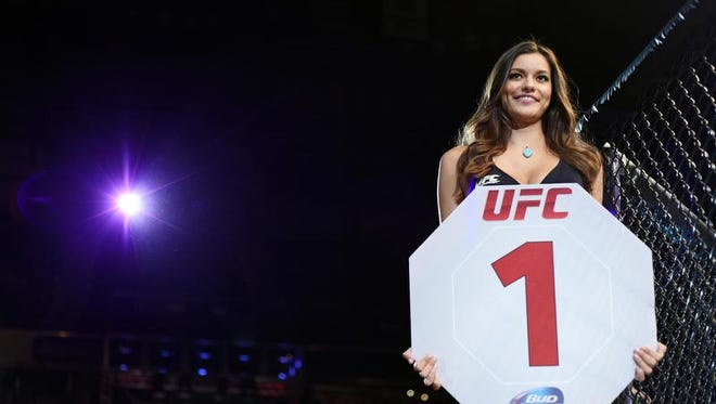 UFC octagon ring girl Vanessa Hanson smiles during the lightweight bout of UFC 177 on Aug. 30 in Sacramento, Calif.