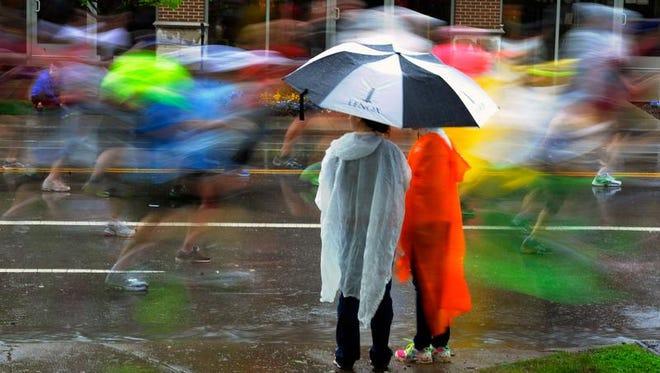 Runners in last year's Country Music Marathon cruise through the rain on Belmont Boulevard.