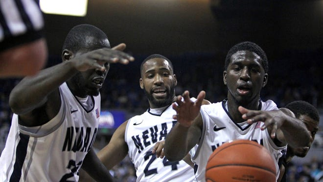 Nevada Wolf Pack Cole Huff (right) reaches for a Boise State Broncos for a rebound in the second half of their NCAA basketball game at Lawlor Events Center.