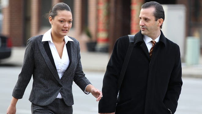 Dawn Nguyen and her lawyer Matt Parrinello before a court hearing last year