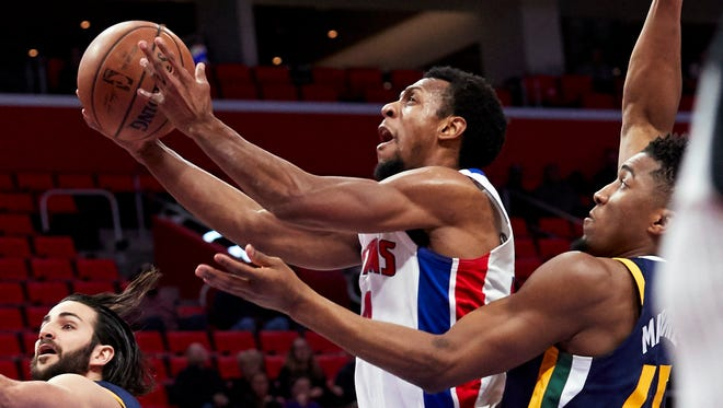 Pistons guard Ish Smith shoots on Jazz guard Donovan Mitchell in the first half Jan. 24, 2018 at Little Caesars Arena.