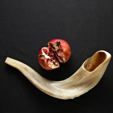 According to Suzanne Fuchs, the pomegranate is used in traditional Rosh Hashanah meals, and the rams horn is used to call attendees to the table, as seen in Phoenix, on Sept. 4, 2014.