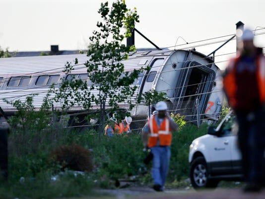 APTOPIX Amtrak Crash_Coat (1).jpg