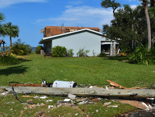 Cleaning uo Hurricane Irma tornado damage in Palm Bay