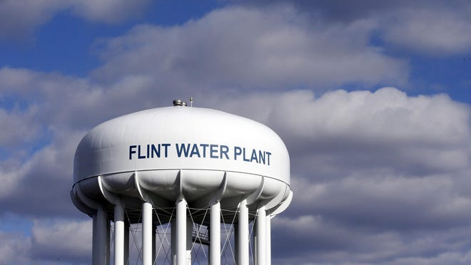 In this March 21, 2016, file photo, the Flint Water Plant water tower is seen in Flint. Michigan Gov. Gretchen Whitmer says a proposed $600 million deal between the state of Michigan and Flint residents harmed by lead-tainted water is a step toward making amends. Officials announced the settlement Thursday, Aug. 20, 2020, which must be approved by a federal judge.