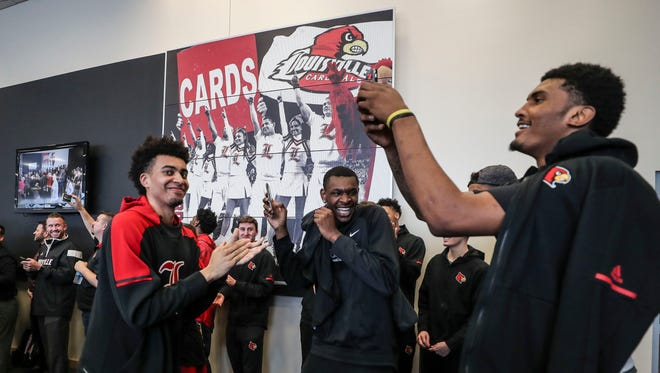 Louisville player Malik Williams smiles while capturing the arrival of newly-hired Louisville basketball coach Chris Mack at his introductory press conference at the KFC Yum! Center Wednesday afternoon, March 28, 2018.