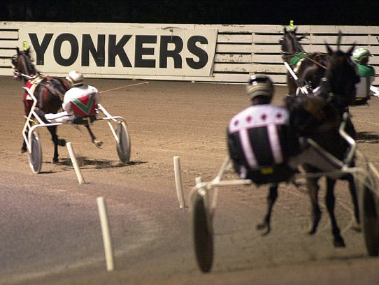 Horses make their way around the track at Yonkers Raceway