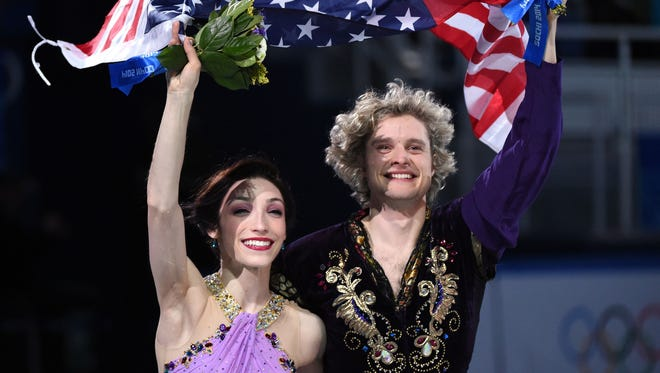 Meryl Davis and Charlie White, Olympic ice dancers. They belong here as a pair after winning Olympic gold (ice dancing) and bronze (overall team ice dancing, United States) medals at the 2014 Sochi Games. Davis and White, both Metro Detroit natives, train in nearby Canton.