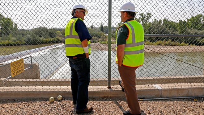 Bob Fredriksen (left), CH2M water operations manager, and David Sypher, public works director, look at the water pumping, Thursday, Aug. 20, 2015, at the Animas Pump Station No. 2 in Flora Vista, N.M.