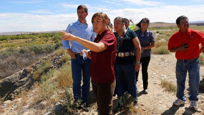 Joni Nofchissey, senior enviromental specialist with the Navajo AML Reclamation Program, talks with U.S. Sen. Martin Heinrich Friday in Shiprock.