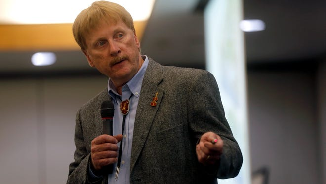Dennis McQuillan, chief scientist for the New Mexico Environment Department gives a presentation Tuesday at San Juan College in Farmington.