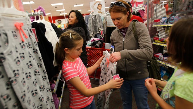 Emily Racine, right, shops for clothes with her mother Tearra Racine and sister Kelsee Racine Wednesday at Target in Farmington.