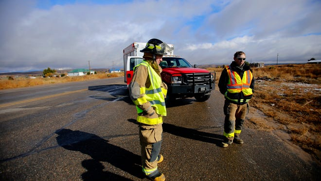 Firefighters with San Juan County Fire Department Fire District 1 block Navajo Service Road 367 in Nenahnezad on Thursday after a truck rollover was reported in the area.