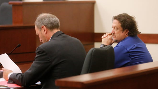 Plaintiff Patrick Cheney, right, sits with his lawyer Chris Hatfield Thursday in Aztec District Court.