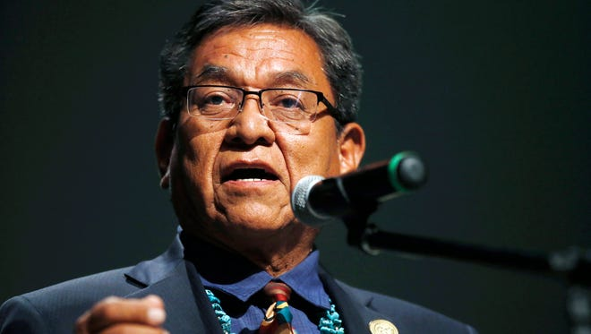 In this July 20, 2015, file photo, Navajo Nation President Russell Begaye talks with community members during a public meeting in Shiprock, N.M. The top two leaders on the Navajo Nation say recent suicides in communities affected by a mine spill have shaken reservation towns to their core.