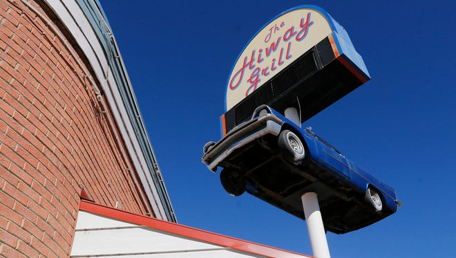 The Hiway Grill's signature De Soto and sign is pictured Wednesday in Aztec. The restaurant's owners announced Monday on Facebook that the business has been closed.