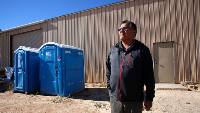 Community Services Coordinator Steven S. Benally talks outside a warehouse Thursday that is used for community meetings for the Navajo Nation's Teec Nos Pos Chapter in Arizona.