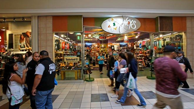 Shoppers walk through the Animas Valley Mall in Farmington on Black Friday.