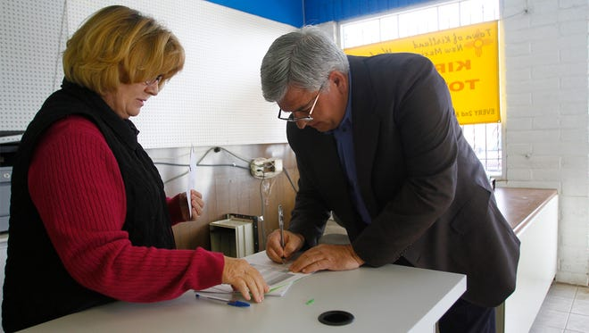 Kirtland Town Clerk Gwen Warner helps Mayor Mark Duncan with his candidacy paperwork on Tuesday at the Kirtland Town Hall. Duncan is running unopposed for the mayor seat in the March 1 election.