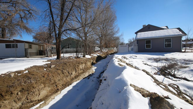 The Blanco Arroyo is pictured Tuesday on Creekside Village Court in Aztec. The City Commission has approved funding for three studies that city officials hope will limit flooding in the town.