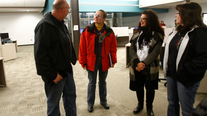 """San Juan College High School Principal Don Lorett, left, talks with San Juan College Dean of Learning Barbara Ake, center, Friday on the SJC campus in Farmington. Ake says the creation of so-called 'meta' majors"""" at the college will help students find a more defined pathway to graduation."""
