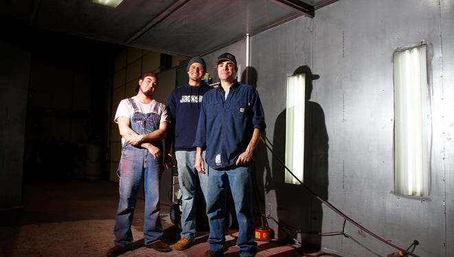 Shop foreman Kevin Sweek, left, powder coater Mike Cortez and owner-operator Clint Haskin pose for a portrait Friday at New Image Powder Coating in Farmington.