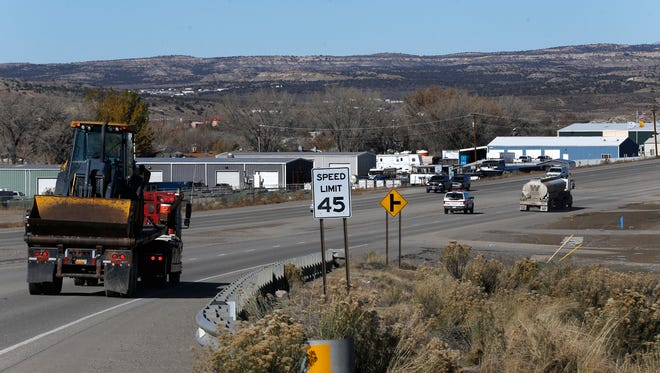 Traffic moves north on U.S. Highway 550 in Aztec in November. State lawmakers are considering a plan that would help catch truckers who don't pay fees to haul their loads across New Mexico highways.