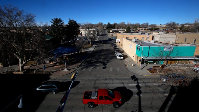 Traffic moves on Friday along Main Street in downtown Farmington. Farmington City Council on Tuesday will discuss hiring an engineering consultant to create blueprints for the Complete Streets project, which is aimed at making the downtown area more pedestrian friendly.